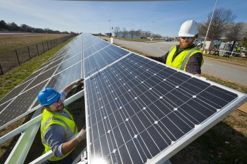 Workers install solar panels at BMW's Greer, SC facility in January 2012. The installation totals 96 kW and produces enough power to run the Zentrum Museum onsite.