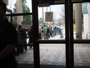 picture of customers waiting in line to sign in at the Greenville public hearing