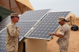 Marine Corps Reserve Col. Anthony Fernandez, commanding officer of Task Force African Lion here, inspects the solar panel of an Expeditionary Forward Operating Base module during the testing phase of this sustainable energy initiative here, May 19.  The ExFOB is designed primarily for use by small Marine Corps units at forward operating bases in Afghanistan.  Fernandez commands more than 700 active duty and reserve Marines and sailors from Marine Forces Reserve, as well as U.S. Army and Air National Guard units which are participating in this annual theater security cooperation exercise.